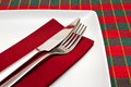 Knife and fork on white square plate Royalty Free Stock Photos