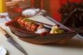 Knife lying near sushi boat.