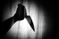 Knife in shadow hand scary Stock Image