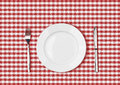 Knife white plate and fork on red picnic table cloth tablecloth Stock Images