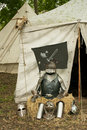 Knight armor a sitting in front of a tent Royalty Free Stock Photography
