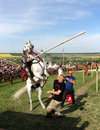 Knight on bucking horse khotyn may with lance riding a during festival medieval khotyn may ukraine Royalty Free Stock Images