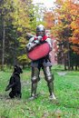 Knight and dog black labrador standing guards a castle fortress medieval protection historical