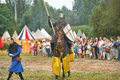 Knight helmet and shield on horseback through the joust days of medieval culture festival vyborg thunder siege legendary events Royalty Free Stock Photo