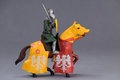 Knight and horse image of toy on gray background Royalty Free Stock Images