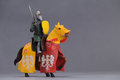 Knight and horse image of toy on gray background Royalty Free Stock Photos