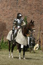 Knight on horse with weapon in hand Stock Photography