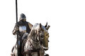 Knight on horseback. Horse in armor with knight holding lance. Royalty Free Stock Photo