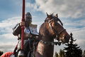 Knight on horseback. Horse in armor with knight holding lance. Horses on the medieval battlefield. Royalty Free Stock Photo