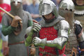 Knight in steel armor, holding hands sword in combat Royalty Free Stock Photo