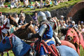 Knights fighting on horseback medieval historical reenactment festival russian fortress priozersk russia Royalty Free Stock Photo