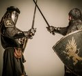 Knights in full body armor fight between two medieval knight Stock Photography