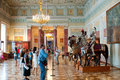 Knights Hall of the Hermitage with shooting tourists Royalty Free Stock Photo