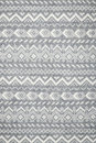 Knit fabric background with knitted grey and white geometric pattern Royalty Free Stock Image
