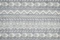 Knit fabric background with knitted grey and white geometric pattern Stock Images