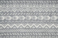 Knit fabric background with knitted grey and white geometric pattern Royalty Free Stock Photos