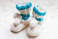 Knitted baby booties blue for little boy Stock Photo