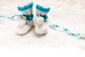 Knitted baby booties blue for little boy with copy space Stock Photos