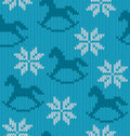 Knitted background with image of snowflakes and ho vector horses Stock Photography