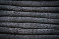 Knitted black wool pattern for background close up Stock Images