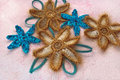 Knitted brown and blue flowers of artificial natural yarn Royalty Free Stock Photo