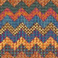 Knitted chevron seamless background pattern on patchwork background Royalty Free Stock Photos