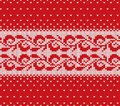 Knitted christmas red and white floral seamless ornament with falling snow. Xmas knit winter sweater texture design. Royalty Free Stock Photo