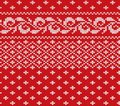 Knitted christmas red and white floral seamless ornament. Xmas knit winter sweater texture design. Royalty Free Stock Photo