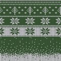 Knitted Christmas sweater pattern with deers, fir-trees, snowflakes. Winter fabric background. Royalty Free Stock Photo