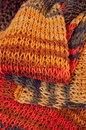 Knitted colorful wintry scarf linen which is a packed up at heap Stock Image