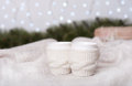 Knitted cups with tea over christmas light Royalty Free Stock Photo
