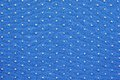 Knitted fabric of blue color with fluffy blond specks texture fine small for abstract backgrounds Royalty Free Stock Photos
