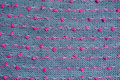 Knitted fabric gray background close up red pink knots Royalty Free Stock Photos