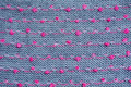 Knitted fabric gray background close up red pink knots Stock Photo