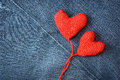 Knitted heart on blue jeans texture background Royalty Free Stock Photo
