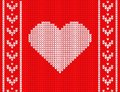 Knitted heart on a red background.