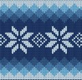 Knitted jacquard pattern detailed blue with white flowers Stock Image