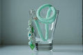 Knitted necklace of mint color in a glass close up Stock Images