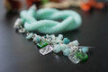 Knitted necklace of mint color with a suspension bracket close up Royalty Free Stock Photos