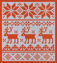 Knitted pattern with reindeer and jacquard flowers highly detailed red white the deer is a norwegian traditional for sweaters Stock Images