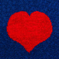 Knitted red heart in the background Royalty Free Stock Image