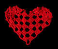 Knitted red heart made of yarn black isolated Stock Image