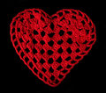 Knitted red heart made of yarn black isolated Royalty Free Stock Photos