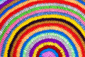 Knitted round carpet or rug