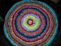 Knitted rug rustic round shape home handmade Royalty Free Stock Photography