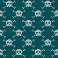Knitted seamless pattern with skulls and crossbones Stock Photo