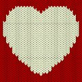 Knitted vector pattern with red heart Stock Image