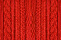 Knitted woolen background, red texture Royalty Free Stock Photo
