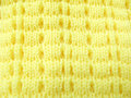 Knitted woollen yellow finely with simple knitting process Royalty Free Stock Image