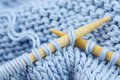 Knitting with bamboo needles Royalty Free Stock Photography